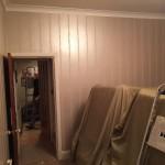 Living room walls before applying wallpaper.