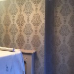Living room walls after applying wallpaper.