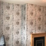 Finished wall that was wallpapered.